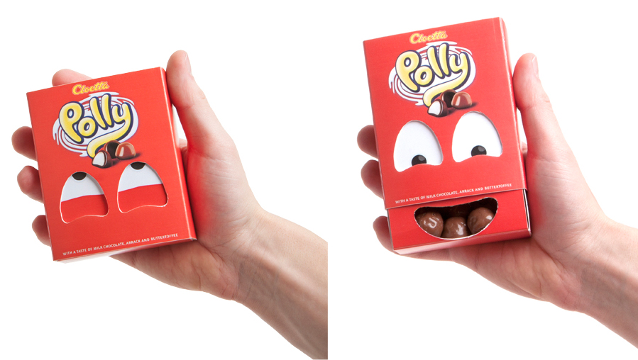 two kids cartons with die cut mouths beach
